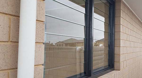 louvre window in commercial frame closed - Fleurieu Glass feature