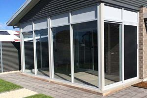 residential sliding doors with commercial fixed windows - Fleurieu Glass and Glazing feature